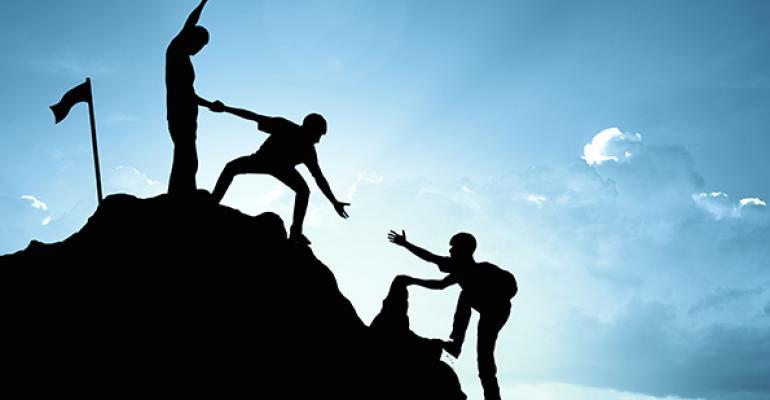 people climbing mountain