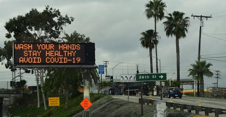 washing hands road sign