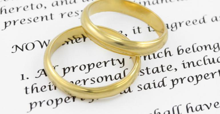 wedding-bands-atop-contract.jpg