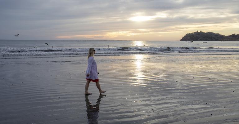 woman-walking-beach-sunrise.jpg