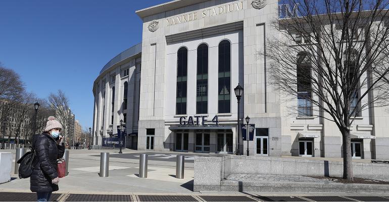 Yankee Stadium empty woman wearing mask