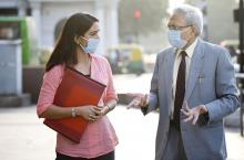 older-businessman-talking-younger-woman.jpg