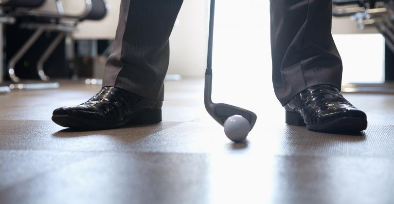 business man golf club