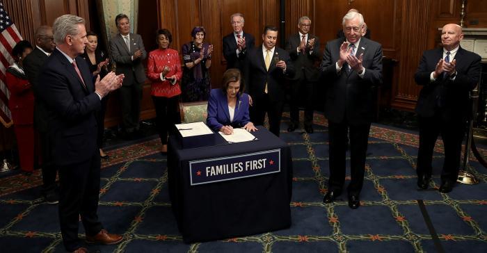 pelosi-signing-stimulus.jpg