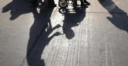 pushing-wheelchair-shadow.jpg
