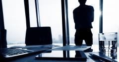 businessman-window-papers.jpg