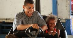 Obama driving bumper cars