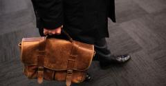 older worker with briefcase