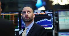 stock market trader looking up