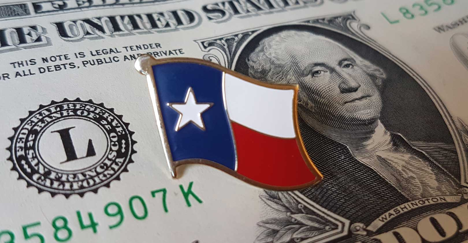 texas flag pin on dollar Luis M iStock Getty.