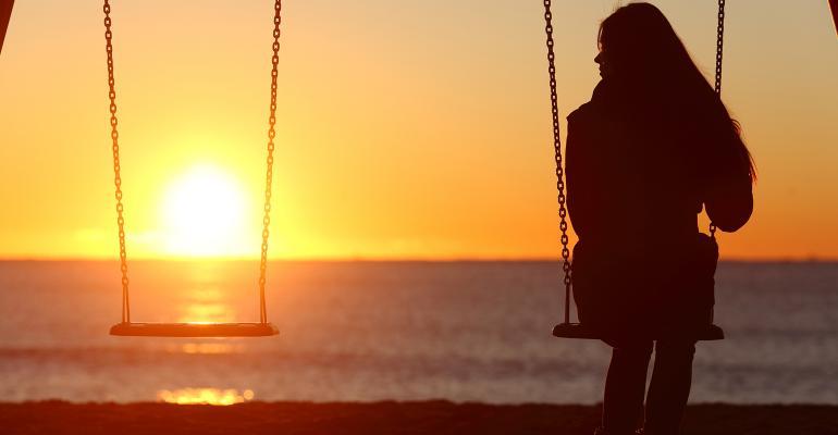 single woman along on swings