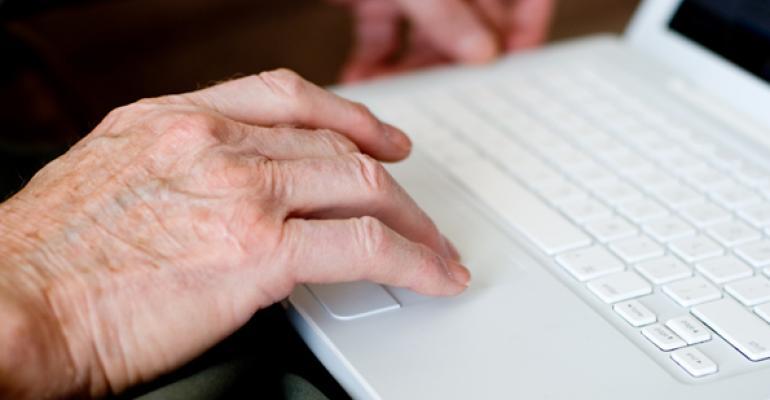 elderly hands laptop
