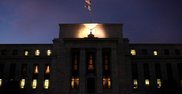 federal reserve building at night