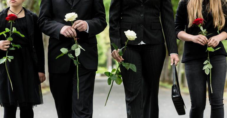 family at funeral with flowers