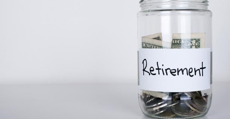 Glass jar with change and Retirement label - Stock Photos : Masterfile
