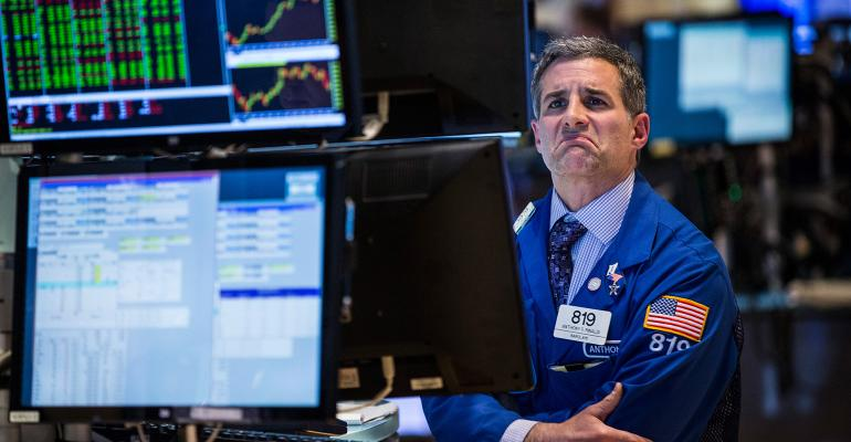 stock market trader frowning