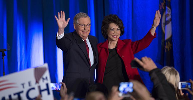 US Sen Mitch McConnell RKY celebrates with his wife Elaine Chao at his election night event on Tuesday