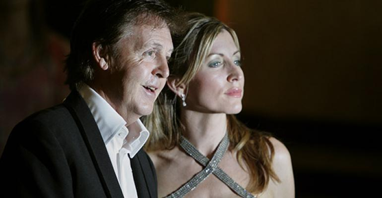 Heather Mills won pound243 million in a divorce settlement from Sir Paul McCartney