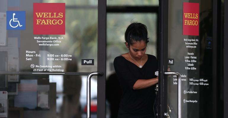 As Regulators Take Aim, Wells Fargo Advisors Say Cross-Selling OK