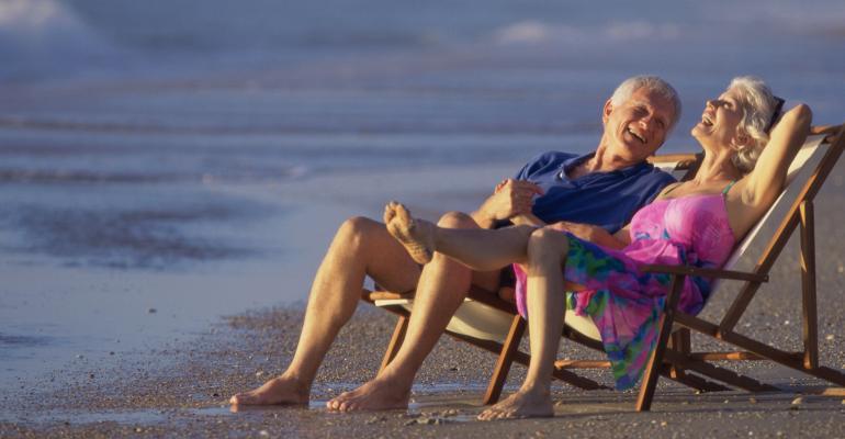 happy retirees beach