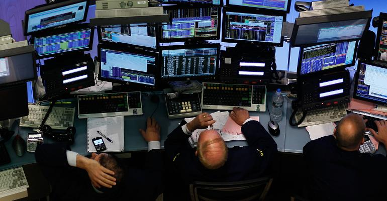 stock market trader crowded desk screens monitors