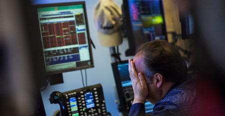 stock market trader hands on face