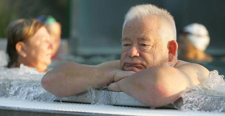 retiree in pool