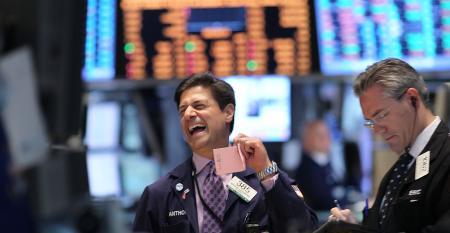 stock market trader laughing